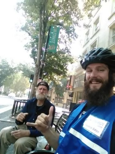 An image of Austin and a homeless man smiling