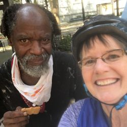 An image of Sister Libby with Clarence, an older homeless man