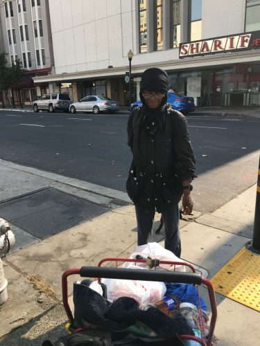 An image of a homeless woman