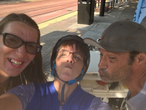An image of Sister Libby smiling with Holly and Chris