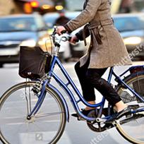 An image of a woman riding a blue bike