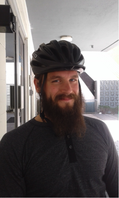 An image of a bearded mercy pedaler volunteer